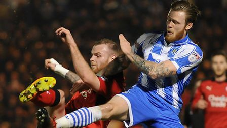 Denny Johnstone of Colchester United does battle with Mark Connolly of Crawley Town. Picture by Rich