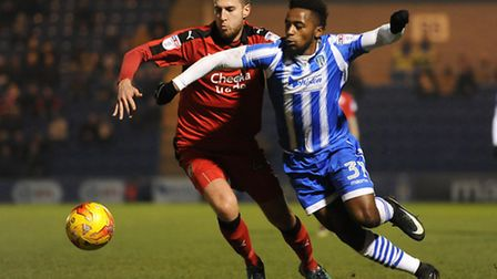 Tariqe Fosu of Colchester United looks to get past Conor Henderson of Crawley Town.Picture by Rich