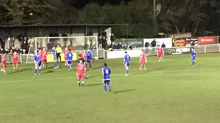 Needham Market defending their own penalty area during a heavy defeat at Billericay Town