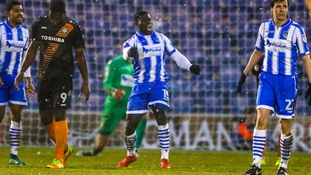 George Elokobi (centre) celebrates at the final whistle after the U's 2-1 home win over Barnet on Sa