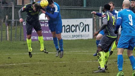A heading duel between Tommy Brewer and Jack Hutchings