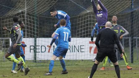 Leiston keeper Jacob Marsden punches clear
