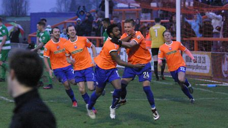 Reece Hall-Johnson celebrates with his Braintree Town team-mates after scoring the winner against No
