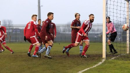 Craig Jennings follows the ball in the net after Sheridan Driver (left) scores for Felixstowe