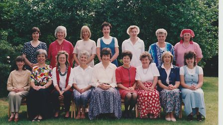 Great Barton school staff from the mid-1990s, with head teacher Sue Spiller in the middle of the fro