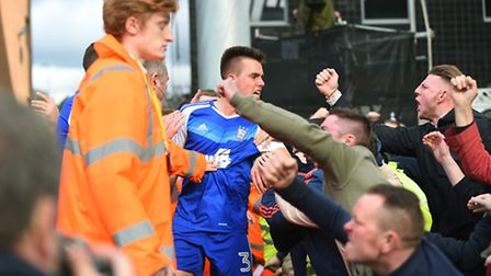 Jonas Knudsen celebrates with the travelling fans after giving Ipswich the lead with this second-hal
