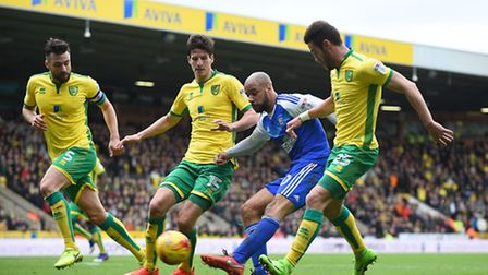 David McGoldrick fires a shot at the Norwich goal late in the first half despite the attentions of t