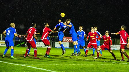 Leiston's Jake Hutchings and Tom Bullard, both go for the ball as the home side pile on the pressure