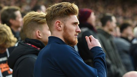 Teddy Bishop watches last Sunday's draw at Carrow Road alongside the Ipswich Town supporters. Photo:
