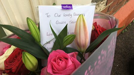 Flowers left outside Richard and Sarah Pitkin's home in Stowmarket. Picture: MATT REASON