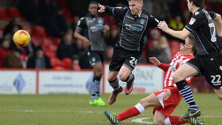 Craig Slater is fouled at Accrington Stanley during his last appearance for the U's, before his hern