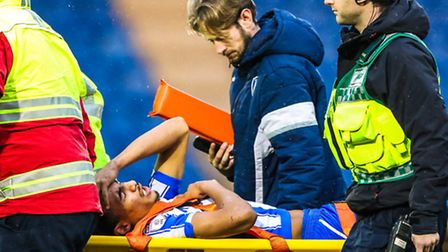 Kurtis Guthrie is taken from the pitch on a stretcher after sustaining an ankle injury late on durin