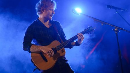 Ed Sheeran's third album has delighted fans. He he is pictured performing a secret show at Latitude