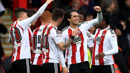 Brentford's Jota celebrates scoring the opening goal of the game during the Sky Bet Championship mat