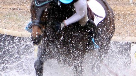 This rider made a great recovery they were very close to a bath in some very muddy water.