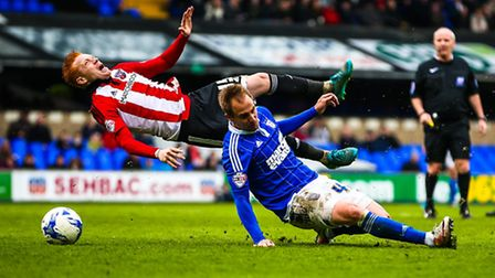 Luke Varney received a yellow card for this tackle on Ryan Woods during Ipswich Town's bad-tempered