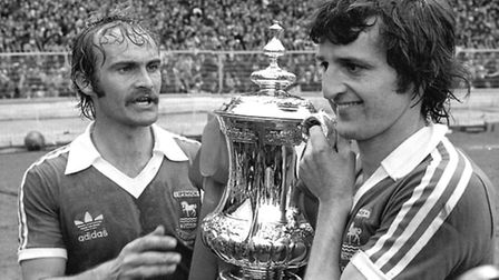 Ipswich Town captain Mick Millls with goal scorer Roger Osborne holding the FA Cup