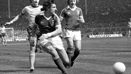 Brian Talbot is one step ahead of Arsenal's Alan Hudson in the FA Cup Final. Kevin Beattie is nearby