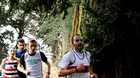 Runners snake through the trees at Nowton Park. In the background is winning lady Odette Robson.