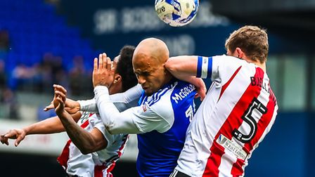 David McGoldrick gets an elbow in the ear, courtesy of Andreas Bjelland during this challenge in the