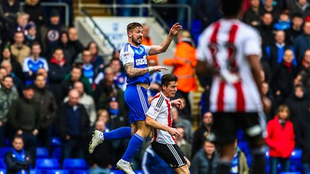 Luke Chambers wins a header in Saturday's 1-1 home draw with Brentford. Photo: Steve Waller