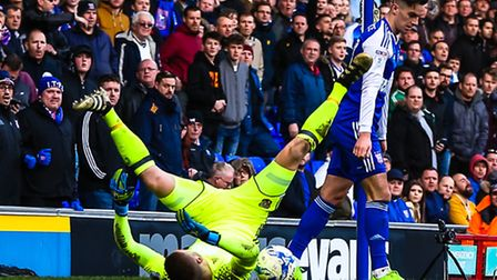 Tom Lawrence leaves Brentford keeper Daniel Bentley in a heap during Saturday's 1-1 home draw. Pict
