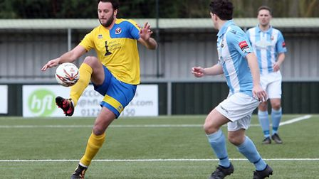 James Baker on the ball for the hosts.