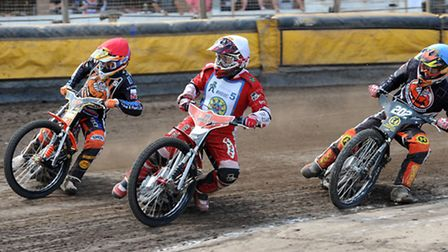 Action from Mildenhall Stadium, West Row, last summer. Mildenhall Fen Tigers have a new sponsor on b