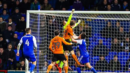 Town keeper Bartosz Bialkowski punches clear late on during last night's goalless draw with Wolves.