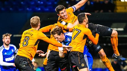 Christophe Berra is outnumbered during this challenge in the Ipswich Town v Wolverhampton Wanderers
