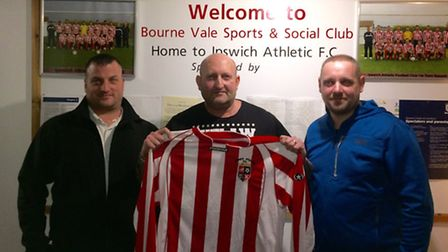 New Ipswich Athletic manager Mark Peck (centre), flanked by his management team; Adam Howes (left) a