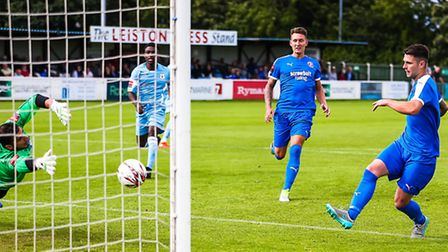 Leiston's Jack Ainsley (right) scores against Grays Athletic earlier this season. Stock image