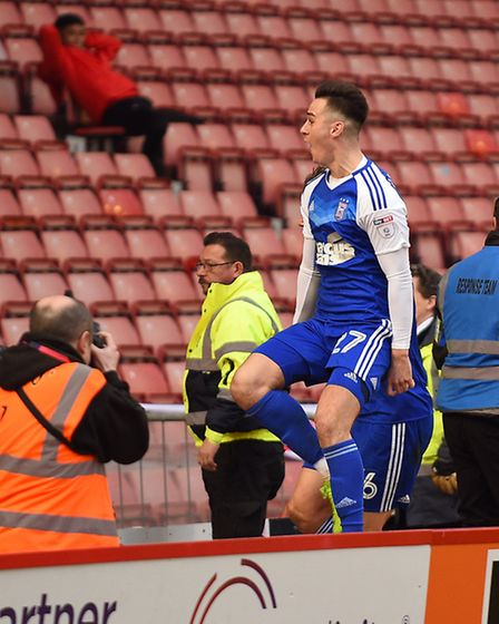 Tom Lawrence celebrates giving Ipswich a share of the points at Oakwell against Barnsley with the la