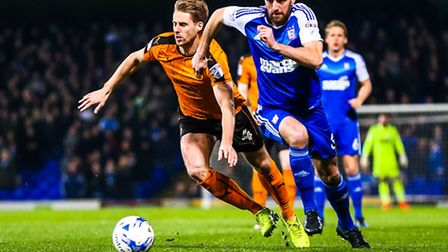 Ipswich Town midfielder Cole Skuse leaves David Edwards in his wake during Tuesday night's goalless