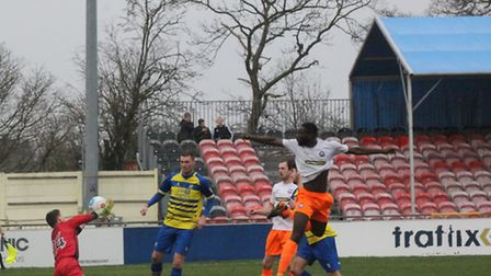 Manny Parry forces a reflex save from the Solihull keeper Baxter