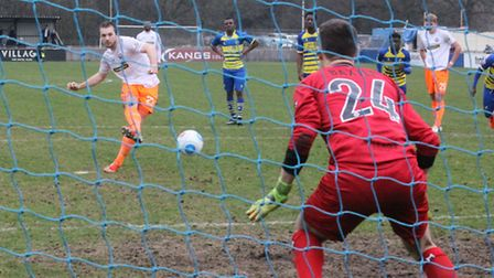 Michael Cheek scores from the penalty spot against Solihull Moors last weekend, to chalk up his 17th