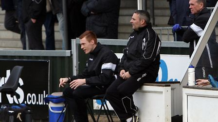 AFC Sudbury boss Jamie Godbold (seated in the centre) has been scratching his head of late as his te