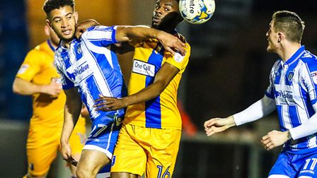 Rekeil Pyke battles with Mansfield's Hayden White during his full debut for the U's last night. Bren