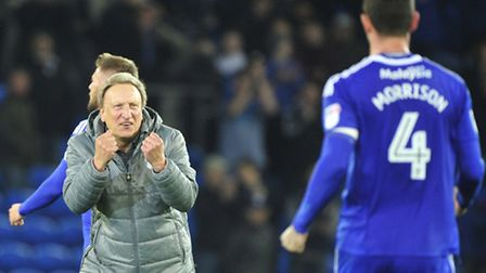 Cardiff City manager Neil Warnock celebrates a win with Sean Morrison. The veteran boss has taken th