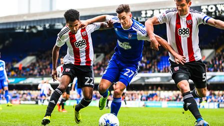 Ipswich Town's Tom Lawrence in a battle with Rico Henry (22) and Andreas Bjelland during the match a