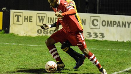 Needham's Reece Dobson retains possession during the 1-1 draw against Merstham. Picture: BEN POOLEY