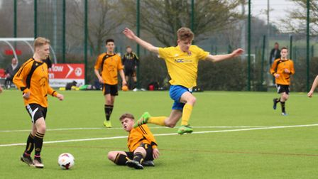 An AFC Sudbury player is tackled by a Mildenhall Town opponent in the Suffolk FA Boys' Under-16 Cup