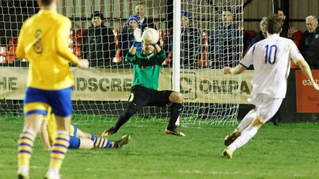 Lowestoft Towns Harvey Hodd forces a good save from Newmarket Town goalkeeper Ben Nower in the seco