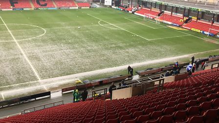 The waterlogged pitch at Gresty Road, an hour before the scheduled kick-off. Referee Graham Horwood