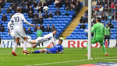 Luke Chambers gives Ipswich the lead with a diving header during the first half at Cardiff. Picture