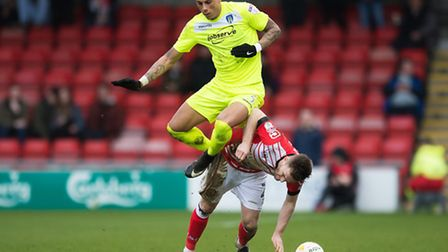 Matthew Briggs of Colchester United does battle with Oliver Turton of Crewe Alexandra