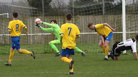 The AFC Sudbury Reserves 'keeper makes a save against Woodbridge Town. Picture: Paul Leech