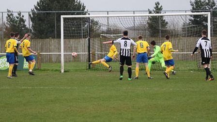 Liam Scopes (number 8) sees his shot cleared off the line for Wodbridge. Picture: Paul Leech