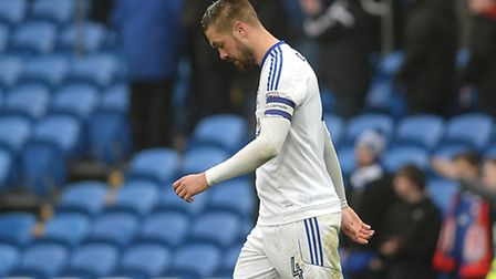 Ipswich Town skipper Luke Chambers walks from the pitch after Saturday's defeat at Cardiff. Photo: P
