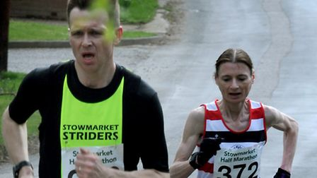 Winning lady Odette Robson is tracking Stowmarket Striders' Tim Larke. Picture: ANDY ABBOTT